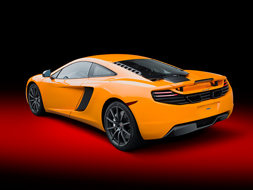 AUT 28 RK0175 01 © Kimball Stock 2012 McLaren MP4-12C Orange 3/4 Rear View In Studio