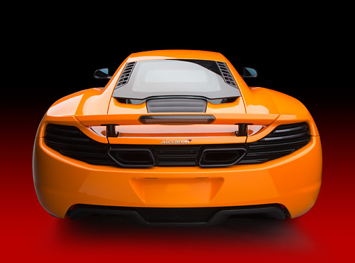 AUT 28 RK0180 01 © Kimball Stock 2012 McLaren MP4-12C Orange Rear View In Studio