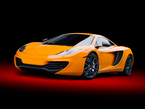 AUT 28 RK0187 01 © Kimball Stock 2012 McLaren MP4-12C Orange 3/4 Front View In Studio