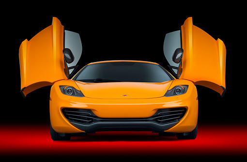 AUT 28 RK0189 01 © Kimball Stock 2012 McLaren MP4-12C Orange Front View With Doors Open In Studio