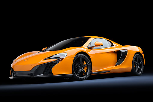 AUT 28 RK0210 01 © Kimball Stock 2015 McLaren 650S Orange 3/4 Front View In Studio