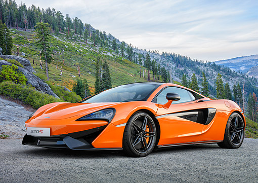 AUT 28 RK0216 01 © Kimball Stock 2015 McLaren 570s Orange 3/4 Front View By Mountain And Trees