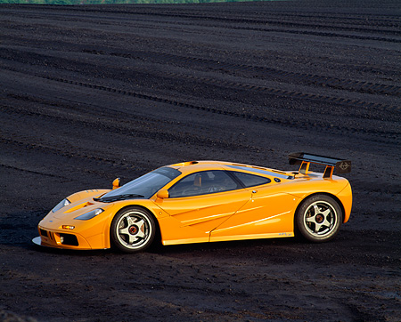 AUT 28 RK0001 04 © Kimball Stock 1996 Orange McLaren F1 LM 3/4 Front On Coal Field