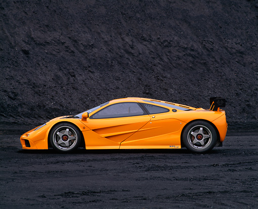 AUT 28 RK0003 05 © Kimball Stock 1996 McLaren F1 LM Orange Profile View On Coal Field