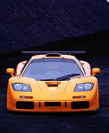 AUT 28 RK0007 01 © Kimball Stock 1996 Orange McLaren F1 LM Head On View In Coal Field