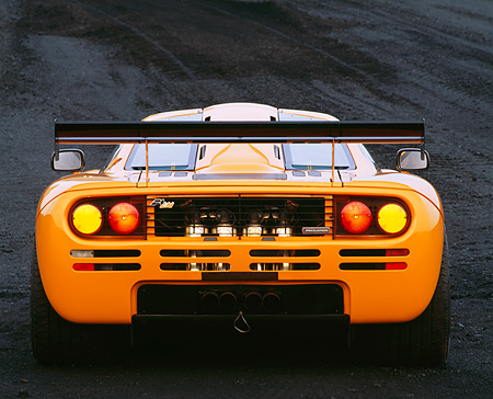 AUT 28 RK0010 02 © Kimball Stock 1996 McLaren F1 LM Orange Rear View Lights On In Coal Field