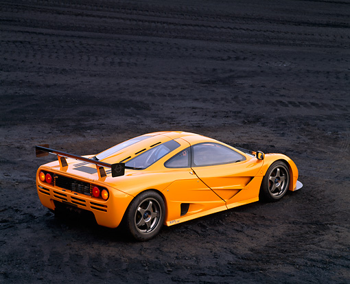 AUT 28 RK0012 04 © Kimball Stock 1996 McLaren F1 LM Orange Overhead 3/4 Rear View On Coal Field