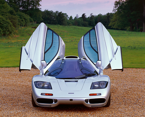 AUT 28 RK0042 04 © Kimball Stock McLaren F-1 Silver Head On View On Gravel