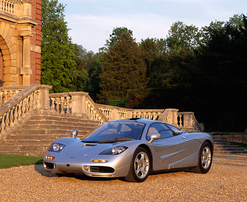 AUT 28 RK0068 05 © Kimball Stock McLaren F1 Silver 3/4 Front On Gravel In Front Of Old Marble Steps At Sundown
