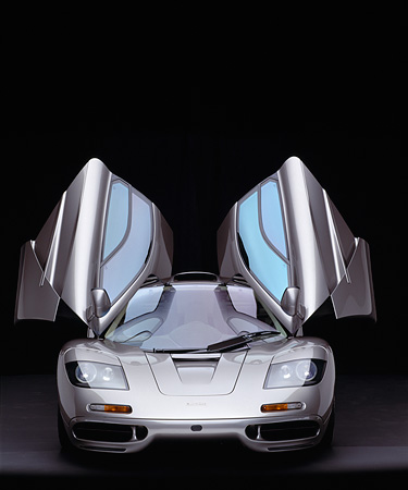 AUT 28 RK0091 08 © Kimball Stock 1995 McLaren F1 Gray Head On View Doors Open Studio