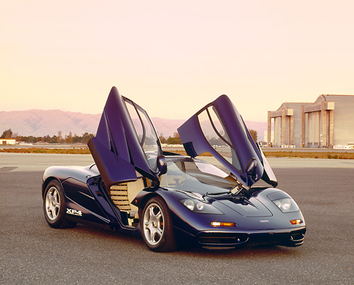 AUT 28 RK0114 01 © Kimball Stock 1993 McLaren F1 XP4 Blue 3/4 Front View Doors Open On Pavement