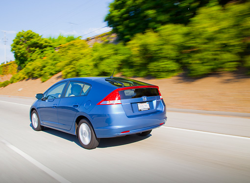 AUT 29 BK0003 01 © Kimball Stock 2010 Honda Insight Blue 3/4 Rear View Driving On Road
