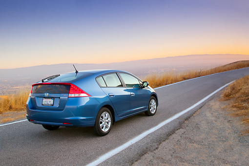 AUT 29 BK0004 01 © Kimball Stock 2010 Honda Insight Blue 3/4 Rear View Driving On Road