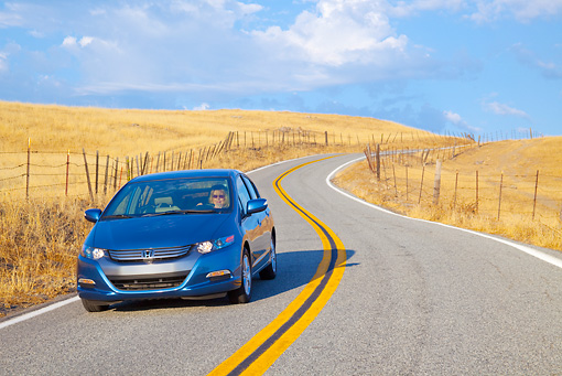 AUT 29 BK0009 01 © Kimball Stock 2010 Honda Insight Blue 3/4 Front View Driving On Road