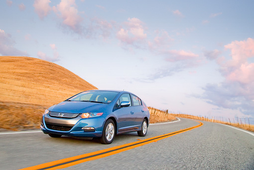 AUT 29 BK0011 01 © Kimball Stock 2010 Honda Insight Blue 3/4 Front View Driving On Road