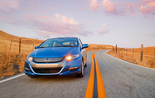 AUT 29 BK0012 01 © Kimball Stock 2010 Honda Insight Blue 3/4 Front View Driving On Road