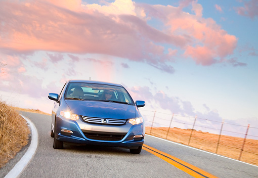 AUT 29 BK0013 01 © Kimball Stock 2010 Honda Insight Blue Front View Driving On Road