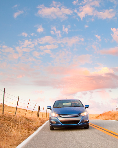 AUT 29 BK0014 01 © Kimball Stock 2010 Honda Insight Blue Front View Driving On Road