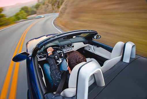 AUT 29 BK0015 01 © Kimball Stock 2009 BMW Z4 Convertible Blue Driving On Road Overhead View
