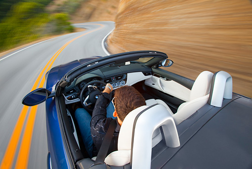 AUT 29 BK0016 01 © Kimball Stock 2009 BMW Z4 Convertible Blue Driving On Road Overhead View