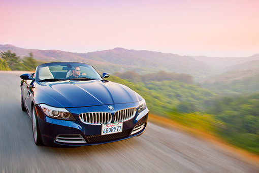 AUT 29 BK0021 01 © Kimball Stock 2009 BMW Z4 Convertible Blue Driving On Road