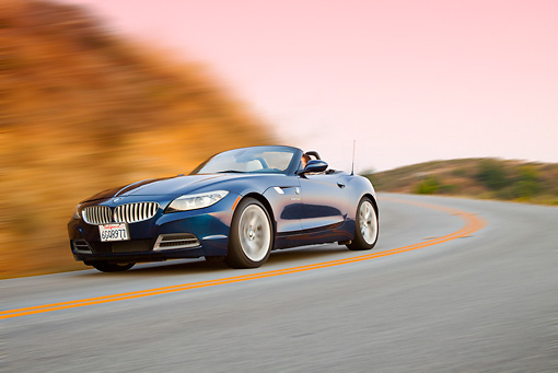 AUT 29 BK0022 01 © Kimball Stock 2009 BMW Z4 Convertible Blue Driving On Road