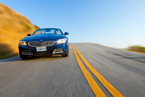 AUT 29 BK0023 01 © Kimball Stock 2009 BMW Z4 Convertible Blue Driving On Road