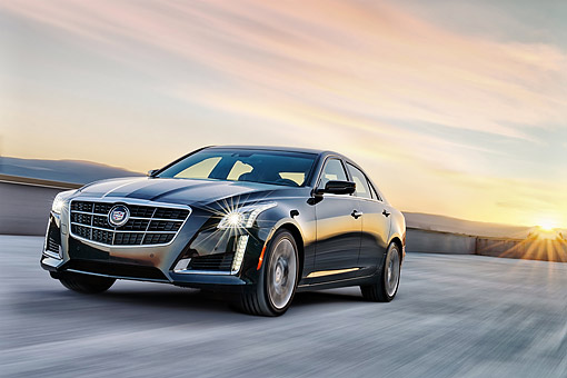 AUT 29 BK0034 01 © Kimball Stock 2014 Cadillac CTS Black 3/4 Front View In Motion On Concrete At Sunset