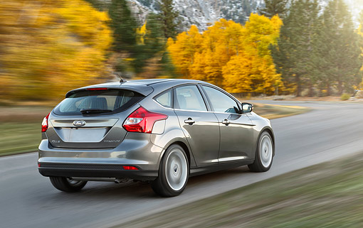 AUT 29 BK0041 01 © Kimball Stock 2014 Ford Focus Titanium Gray 3/4 Rear View On Pavement In Motion By Autumn Trees