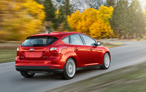 AUT 29 BK0042 01 © Kimball Stock 2014 Ford Focus Titanium Gray 3/4 Rear View On Pavement In Motion By Autumn Trees
