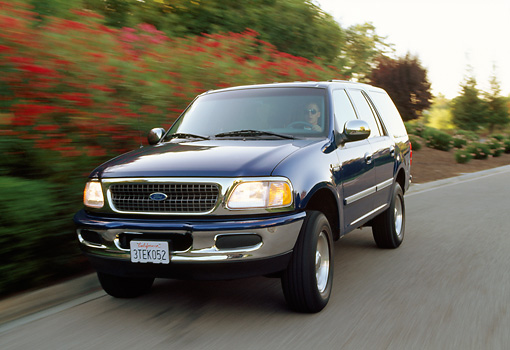 AUT 29 RK0005 07 © Kimball Stock 1997 Ford Expedition Blue Front 3/4 View On Road In Motion