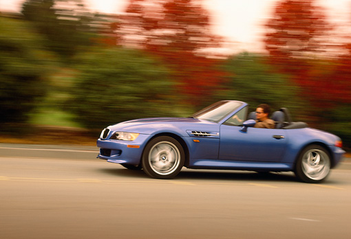 AUT 29 RK0169 01 © Kimball Stock 1999 BMW M Roadster Z3 Convertible Blue Profile View On Road In Motion