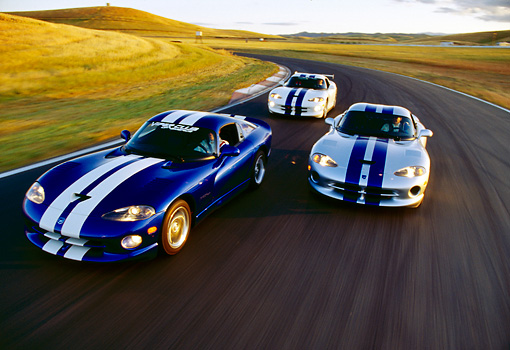 AUT 29 RK0340 01 © Kimball Stock Three Dodge Vipers In Motion On Race Track