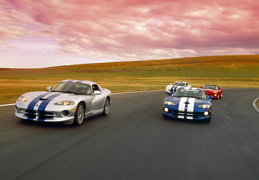 AUT 29 RK0343 03 © Kimball Stock Group of Dodge Vipers on Race Track