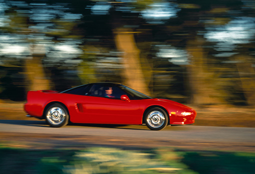 AUT 29 RK0395 03 © Kimball Stock 1991 Acura NSX Red Profile View On Road In Motion