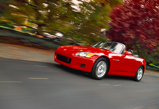 AUT 29 RK0465 01 © Kimball Stock 2000 Honda S2000 Convertible Red Low 3/4 Front View On Road In Motion