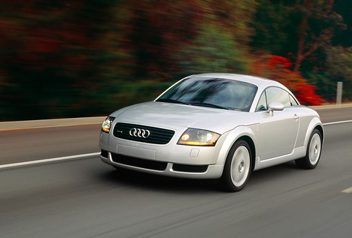 AUT 29 RK0485 09 © Kimball Stock 2000 Audi Quattro TT Coupe Silver In Motion On Road Front 3/4 View