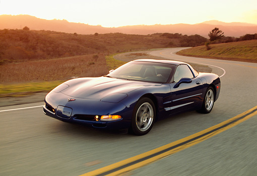 AUT 29 RK0582 01 © Kimball Stock 2002 Chevrolet Corvette Z06 Coupe Blue 3/4 Front View On Road In Motion