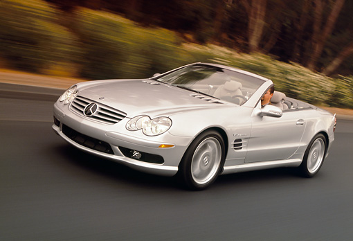 AUT 29 RK0628 17 © Kimball Stock 2003 Mercedes-Benz SL55 AMG Roadster Silver 3/4 Front View On Road In Motion