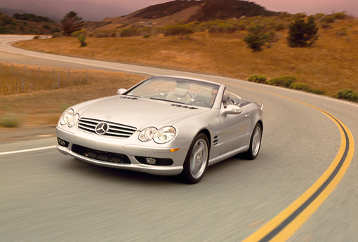 AUT 29 RK0630 27 © Kimball Stock 2003 Mercedes-Benz SL55 AMG Roadster Silver 3/4 Front View On Road In Motion Filtered