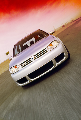 AUT 29 RK0693 02 © Kimball Stock 2005 Volkswagen R32 Golf Silver Head On Shot On Road In Motion Filtered