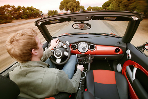 AUT 29 RK0786 01 © Kimball Stock 2005 Mini Cooper Convertible Orange In Motion With Driver