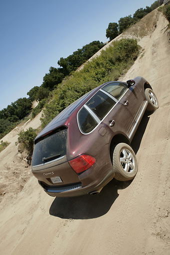 AUT 29 RK0802 01 © Kimball Stock 2004 Porsche Cayenne Burgundy 3/4 Rear View In Motion On Dirt Road