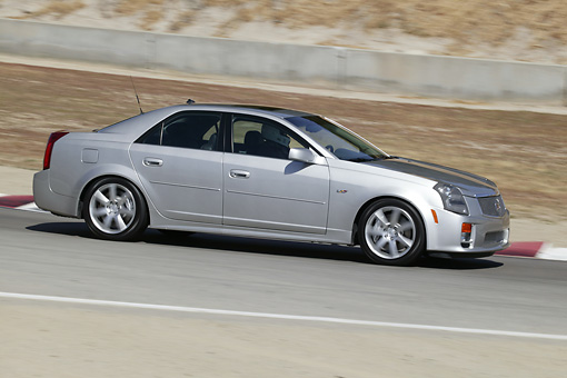 AUT 29 RK0804 01 © Kimball Stock 2004 Cadillac CTS-V SLV Silver 3/4 Side View On Pavement In Motion