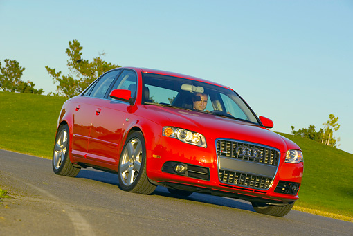 AUT 29 RK0880 01 © Kimball Stock 2006 Audi, A4, 2.0 T, Red Low 3/4 Front View On Road In Motion By Grass Hills
