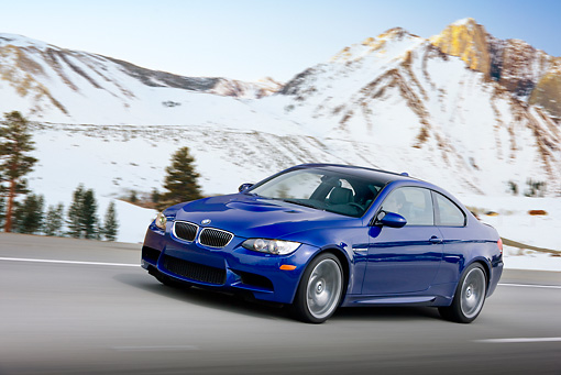 AUT 29 RK1461 01 © Kimball Stock 2008 BMW M3 Coupe Blue In Motion On Road By Snowy Mountains
