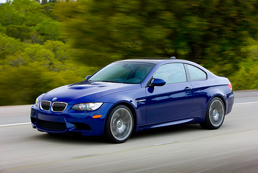 AUT 29 RK1462 01 © Kimball Stock 2008 BMW M3 Coupe Blue In Motion On Road By Trees