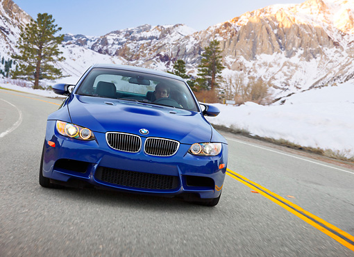 AUT 29 RK1464 01 © Kimball Stock 2008 BMW M3 Coupe Blue In Motion On Road By Snowy Mountains