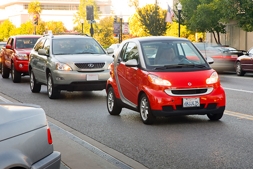 AUT 29 RK1467 01 © Kimball Stock 2009 Smart Fortwo Passion Coupe Red And Silver Driving On Street