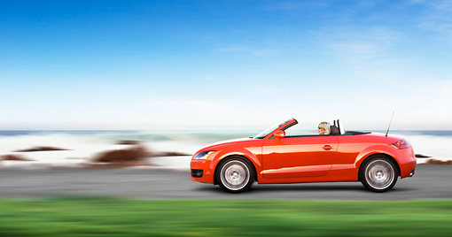 AUT 29 RK1468 01 © Kimball Stock 2008 Audi TT Convertible Red Profile View Driving By Beach